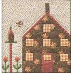 QUILTED VILLAGE #9 COTTAGE WITH BIRDHOUSE